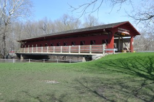 Visitors can drive or walk/bike across the bright red Covered Bridge at Lake of the Woods.