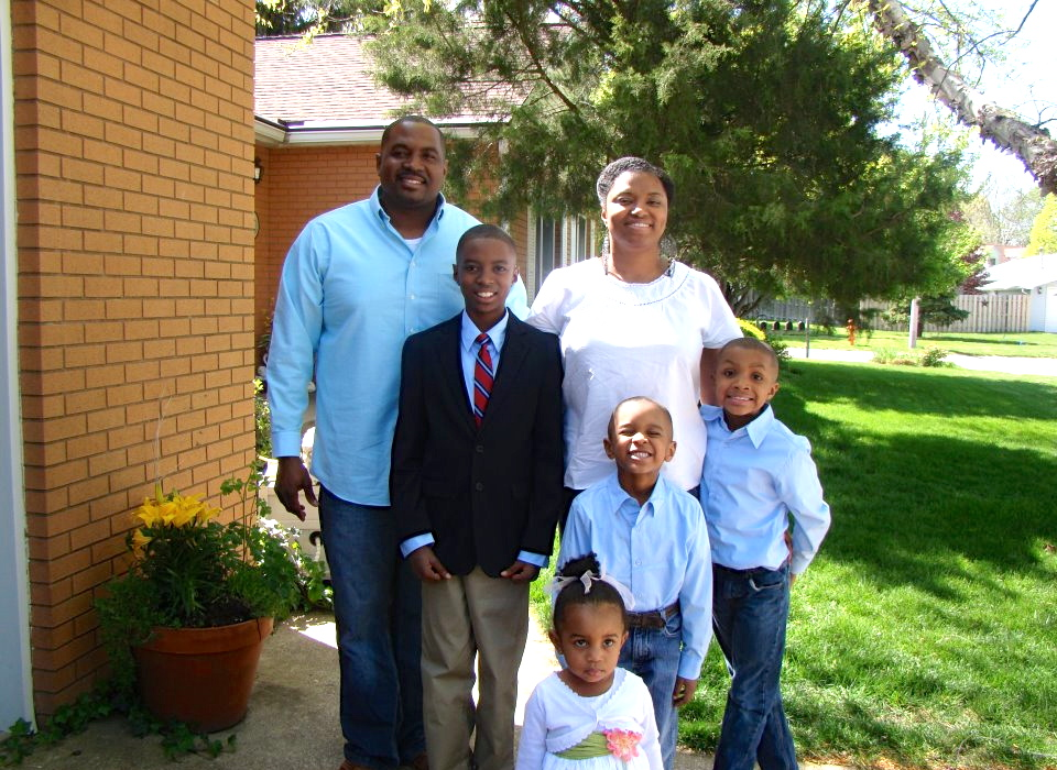 Urbana's Asia Fuller Hamilton, principal of Booker T. Washington Elementary in Champaign, with her beautiful family of six. Photo provided.