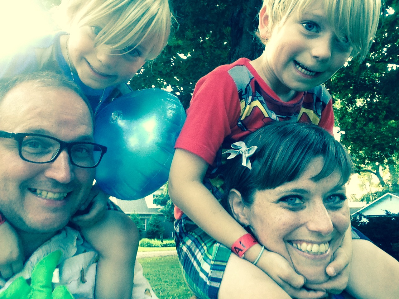 Bryan Phelps is this week's Chambana dad to know. Bryan is left with son Judah on his shoulders, I am the one in glasses. Jolee Phelps, right, has son Alex on her shoulders. Photo provided.