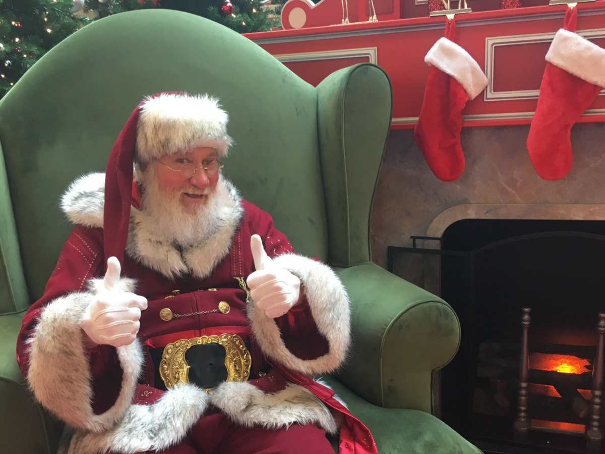 santa claus is ready for his first visitor of the day at market place mall in champaign on dec 14 photo credit kelly youngblood - Pictures With Santa Claus