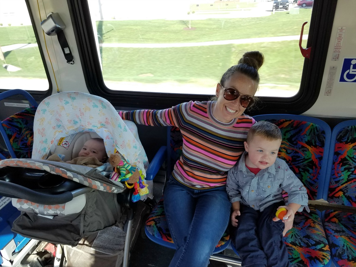 a young family rides the bus in champaign-urbana on chambanamoms.com