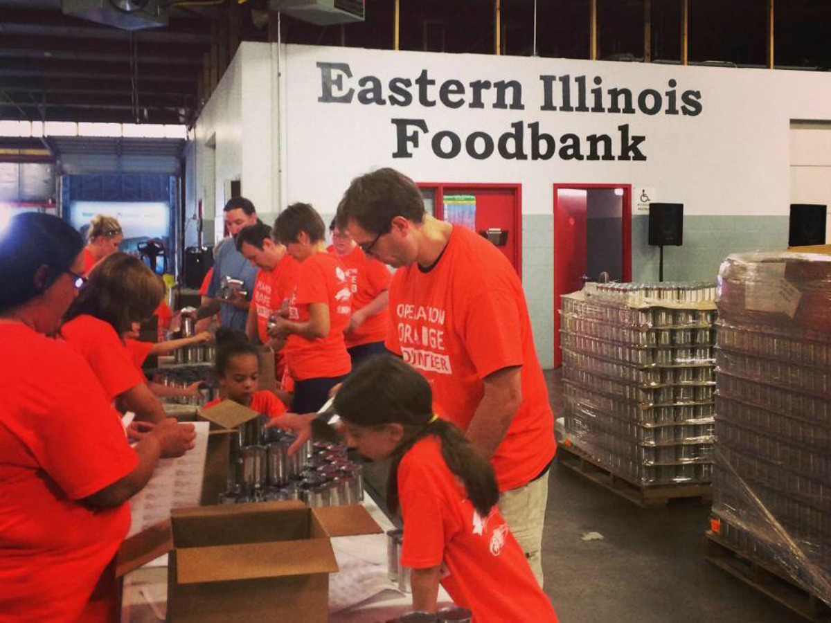 Champaign Urbana Family Volunteering Food Sorting At