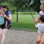 Parents swinging with children at Hessel Park