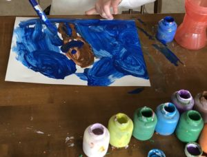 Kids painting while parents work from home
