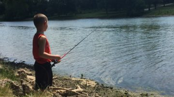 Child fishing at Lake of the Woods in Mahomet