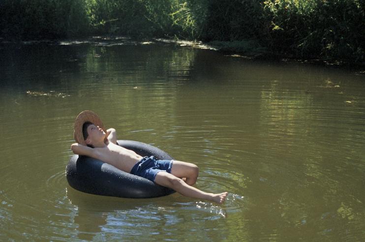 child floating on inner tube